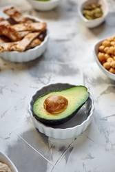 Avocado split in half on the table