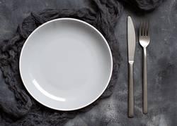 Grey plate on a dark background