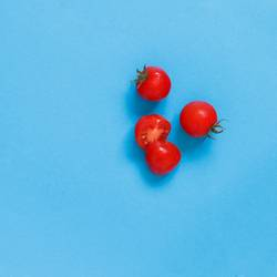 Cherry tomatoes on a blue background