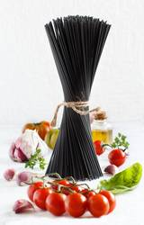 Raw squid ink pasta and vegetables
