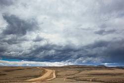 Road and stormy clouds