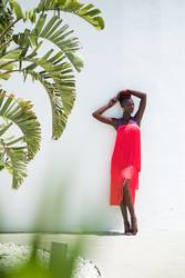Attractive black woman wearing coral fringed dress