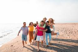Multicultural group of friends partying on the beach