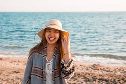 Happy young Asian woman in the beach.