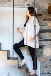 Beautiful smiling pregnant woman going up stairs