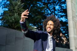 young afro american man smiling happy taking selfie