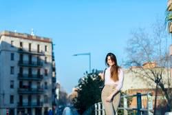 young beautiful woman in casual wear walking outdoors