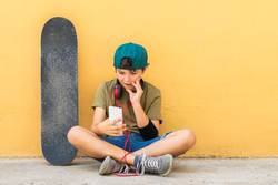 Portrait of a teenager sitting on the floor