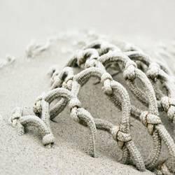 Spiekeroog-Netz voll Sand
