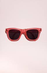 Red bright sunglasses on a pastel pink background. Summer time