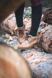 Women's leather casual shoes on wood in the forest