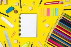 Minimal work space Colorful background with many crayons,