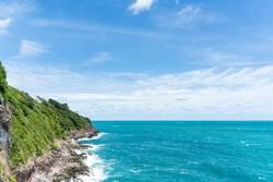 Sea waves breaking against cliff