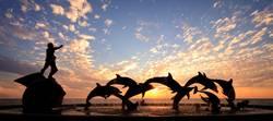 Dolphin statue in Mazatlan frames a beautiful sunset
