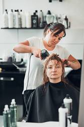 Hairdresser styling womans hair