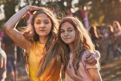 Portrait of happy young girls on holi color festival