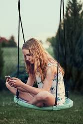 Young woman using mobile phone smartphone