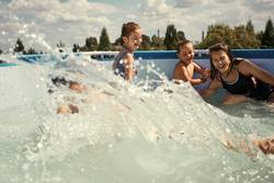 Children splashing in a pool