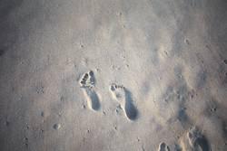 Fussabdrücke im Sand
