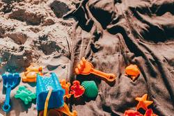 close up of some kid toys in the sand
