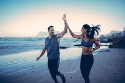 Fit Couple giving each other high five