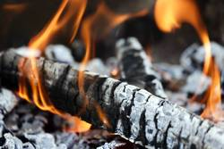 Closeup of the wood burns on fire