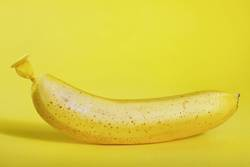 Abstract banana from balloon on yellow background