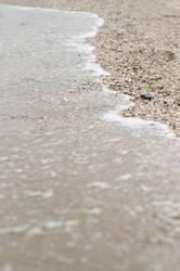 Sand umspülendes Meer