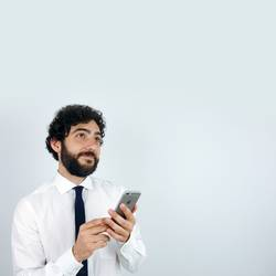 Business man with mobile phone in his hand