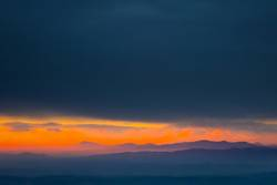 Sunset over hills in countryside
