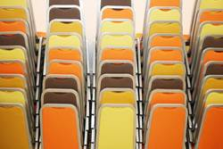 Stacks of colorful chairs