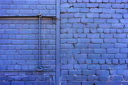 Dyed lilac brick wall with crochet