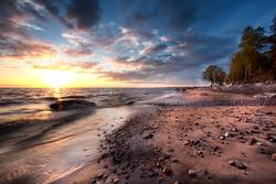 Sandy beach with rocks at the sea. Baltic sea
