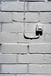 Electrical switch on the white wall