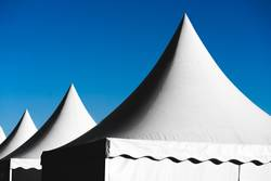 Pointed tents against the blue sky