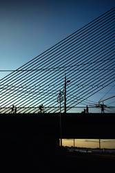 Bridge at sunset with silhouettes