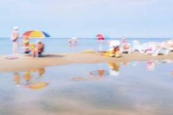 Vacationers people on a day in the summer sea beach