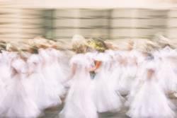 Girls in white dresses in summer