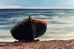 Wooden boat on the sandy shore