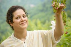 Portrait of a happy young woman holding a plum branches