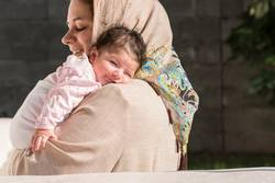 Muslim mother embraced a newborn baby in outdoor