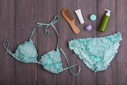 swimsuit and accessories: wooden hairbrush, sunscreen