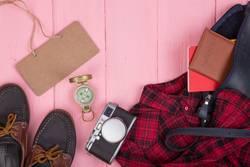 bag, passport, camera, compass, shoes, shirt, note pad