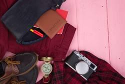 Tourist stuff - bag, passport, camera, compass, shoes, shirt