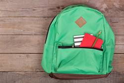Backpack and school supplies: notepad, pencil