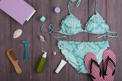 swimsuit, flip flops and accessories: hairbrush, sunscreen