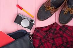 Tourist stuff - bag, camera, shoes, shirt, note pad