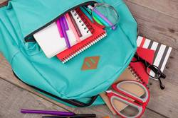 Backpack, magnifying glass, notepad, scissors