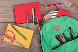 Backpack, books, pencils, notepad, eyeglasses, scissors
