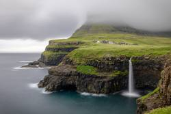View of Mulafossur waterfall in Faroe Islands